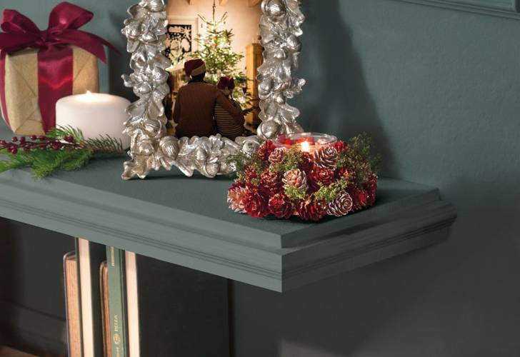 Centrotavola portacandela bouquet pigne natalizio