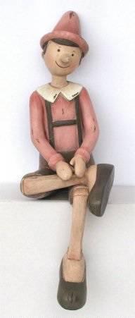 Pinocchio seduto rosa